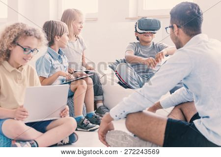 Afro-american Kid Uses Vr Glasses During Technology Lesson For Children