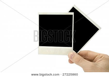 Two photo cards in hand isolated on white background