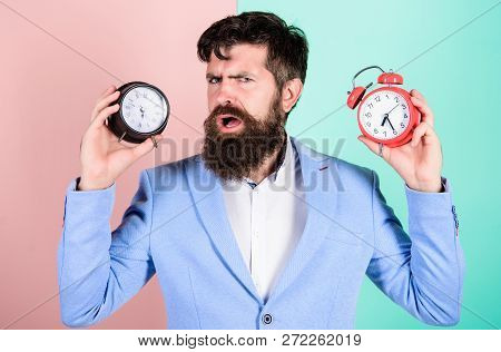 Guy Unshaven Puzzled Face Having Problems With Changing Time. Time Zone. Does Changing Clock Mess Wi