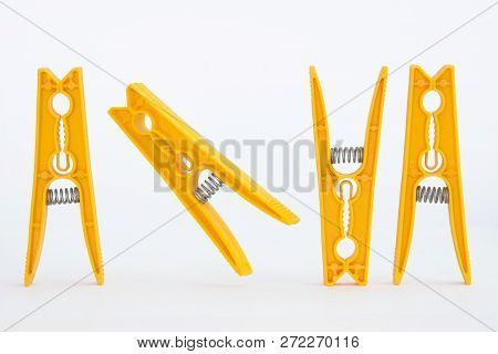 For Yellow Dancing Pegs On A White Background