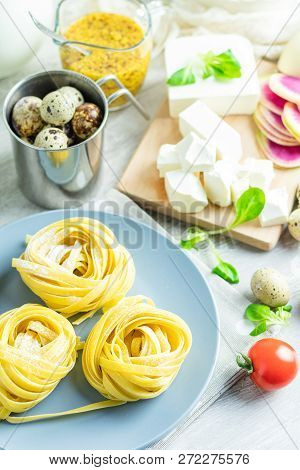 Raw Homemade Italian Typical Pasta Linguine Noodles On Plate