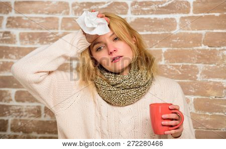 Woman Feels Badly Ill Sneezing. Girl In Scarf Hold Tea Mug And Tissue. Runny Nose And Other Symptoms