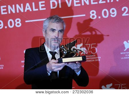 Alfonso Cuaron poses with Golden Lion for the best movie fo 'Roma' at the Winners Photocall during the 75th Venice Film Festival at Sala Grande on September 8, 2018 in Venice, Italy.