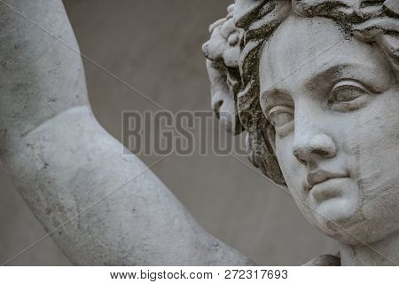 Ancient statue of sensual Greek renaissance era woman with a flower, Potsdam, Germany poster