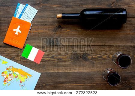 Gastronomical Tourism. Italian Food Symbols. Passport And Tickets Near Italian Flag, Bottle Of Red W