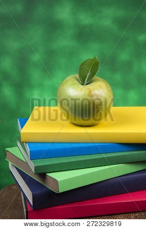 Apple Fruit On Top Of A Book Stack, On The Back Of School Classes.