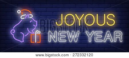 Joyous New Year Neon Sign. Glowing Inscription With Piglet Holding Gift Box On Brick Wall Background