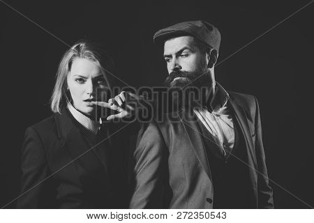 Couple Of Detectives Or Researchers, Private Investigators. Man And Woman In Retro Suit And Hat On B