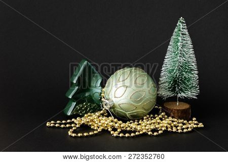 A Christmas decoration glass ball with fir trees