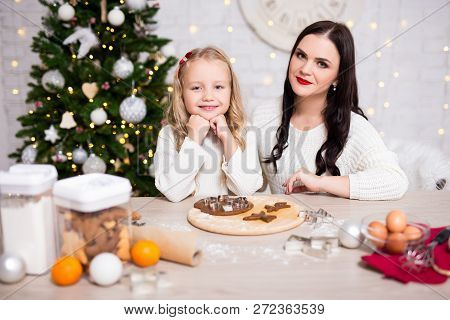 Happy Mother And Daughter Cooking Christmas Cookies In Kitchen
