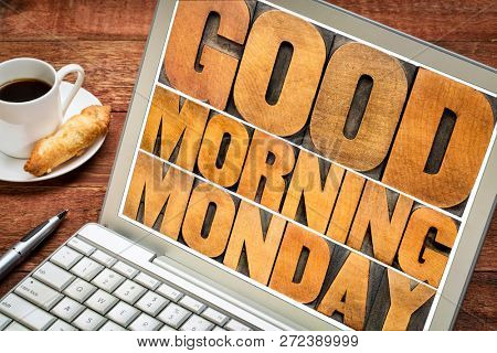 Good Morning Monday word abstract - text in vintage letterpress wood type printing blocks on a laptop screen with a cup of coffee