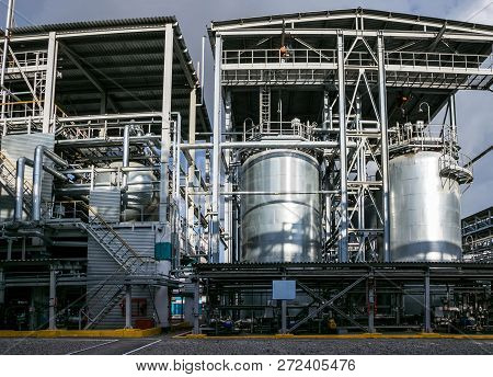 Chemical factory. Elastomer and thermoplastic production line. Large vats for preparing monomers and polymerization. poster