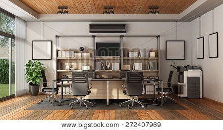 Modern Boardroom With Meeting Table And Bookcase - 3d Rendering