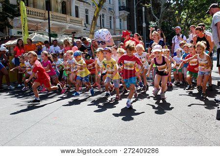 Odessa, Ukraine - Circa Aug 2018: Children Marathon, Kids On Starting Line. Marathon Runners Kids At