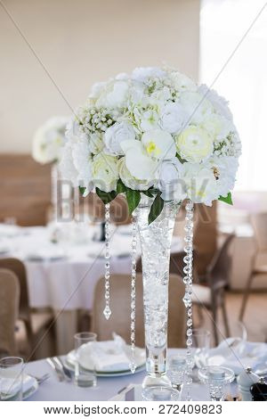 Classic Light And Elegance Wedding Table Decoration With White Flowers Bouquet And Crystals.