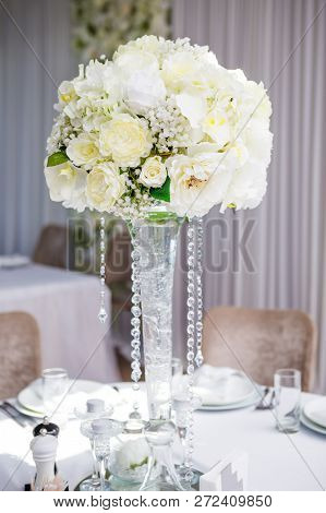 Close Up Picture Of Elegance Wedding Table Decoration With White Flowers Bouquet And Crystals. Festi