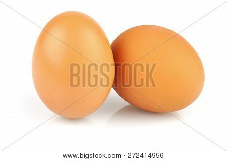 Brown Eggs Isolated On White Background. Two Eggs