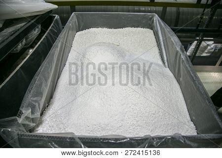 White Powder Thermoplastic Polymer In Storage Tank