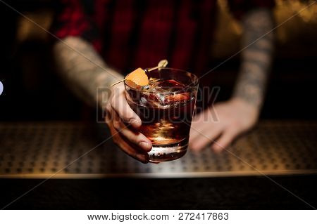 Professional Bartender Serving A Delicious Godfather Cocktail