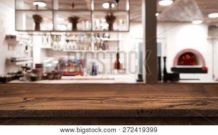 Table Counter On Blurred Interior Of Rustic Style Restaurant Kitchen