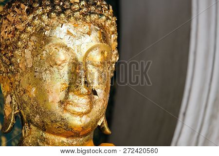 Buddha In Temple With Gold Leaf (buddhism Religion) For Background Or Texture.