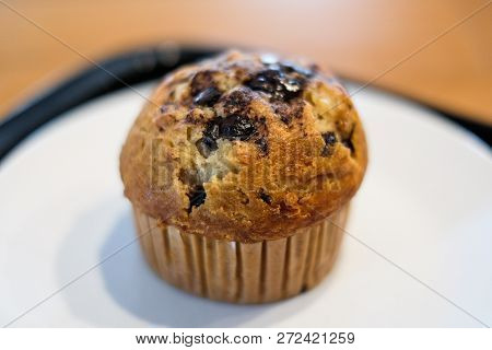 Muffin Chocolate Lava With Chocolate Chip And Banana Smell In Paper Cup For Dessert Background Or Te