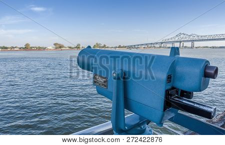 New Orleans, Usa - Dec 4, 2017: View Across The Iconic Mississippi River With A Coin-operated Telesc
