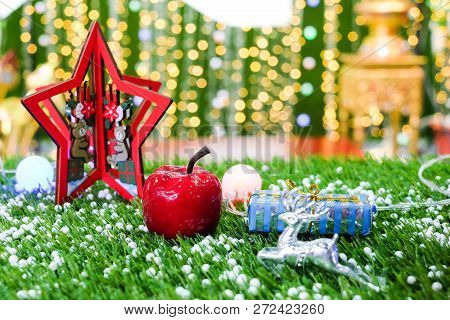 The Red Star With Apple & Reindeer On Grass For Background Or Texture - Merry Christmas And Happy Ne