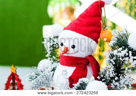 The Snowman With Red Wool Hat With Christmas Tree For Background Or Texture - Merry Christmas And Ha