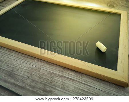 Blank Chalkboard With Chalk On Wooden Background