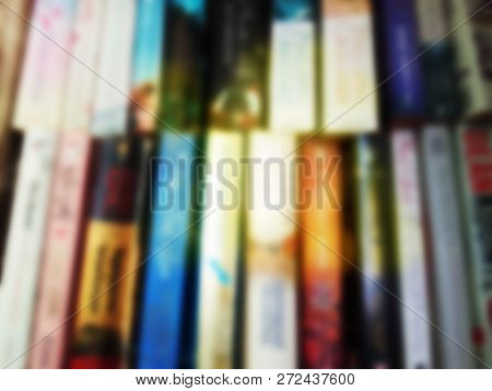 Bright Colorful Vintage Blurred Picture Of Books On The Shelves