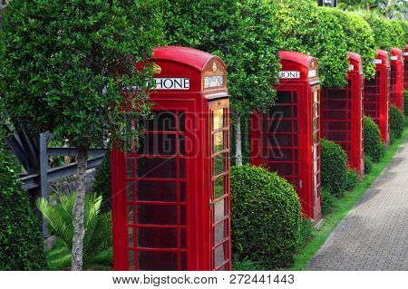 Many Traditional Uk Red Callbox In Garden