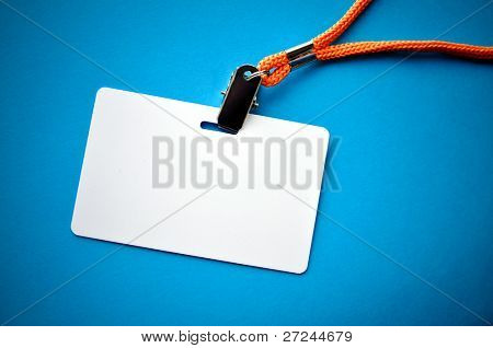 Blank ID card / badge with copy space, isolated on blue.