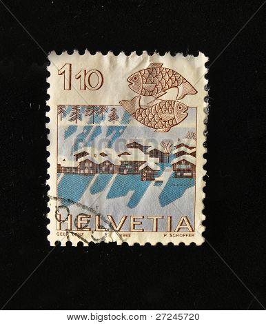 HELVETIA (SWITZERLAND) - CIRCA 1984: A Stamp printed in the HELVETIA shows Signo  Pisces , circa 1984.