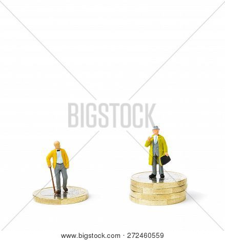 Small Figurines And Stacks Of Euro Coins On Bright Background. Inequality, Starvation Wages And Inco