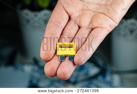 Woman Hand Holding Yellow Amp Rated Car Fuses Before Inserting Them Fuse Box Closeup Shot