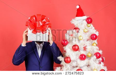 Head Downtrodden With Thoughts What To Gift. Man Bearded Formal Suit Carry Gift Box On Head. Christm