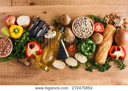 Healthy Eating. Mediterranean Diet. Fruit,vegetables, Grain, Nuts Olive Oil And Fish On Wooden Table