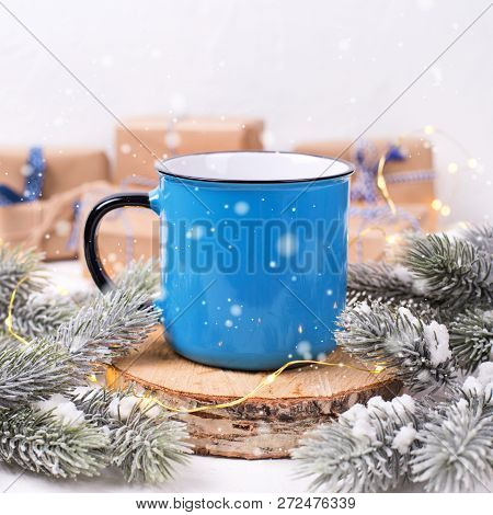 Blue Mug With Hot  Tea, Coffee Or Cocoa On Winter Holidays Background.fir Tree Branches, Wrapped Pre