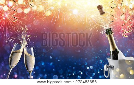 Celebration Toast With Champagne And Fireworks - Happy New Year