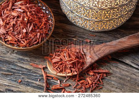 Red Sandalwood Chips On A Spoon On A Table
