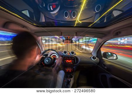 Urban High Spees Driving On A Smal City Car With Panoramic Roof. View From Inside Car Natural Light