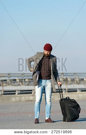 Moving To New City Alone. Traveler With Suitcase Arrive Airport Railway Station Urban Background. Hi