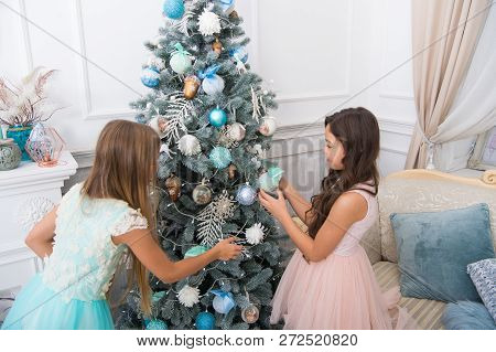 Happy Little Girls Sisters Celebrate Winter Holiday. Decorate Christmas Tree. Happy New Year. Christ