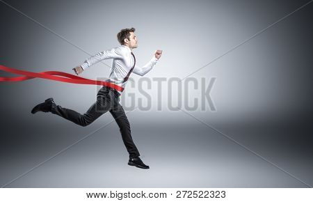portrait of running businessman who is winning a business challenge
