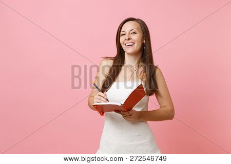 Smiling Bride Woman In Wedding Dress Planning Wedding Writing Notes In Diary, Notebook Choosing Of S