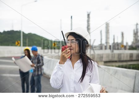 Woman Construction Engineer Concept.young Women Engineer Wear Safety Hat (helmet) Holding Portable R