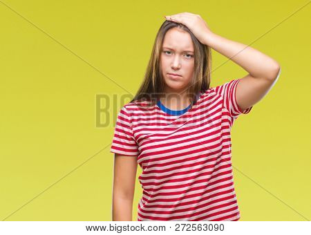 Young caucasian beautiful woman over isolated background confuse and wonder about question. Uncertain with doubt, thinking with hand on head. Pensive concept.