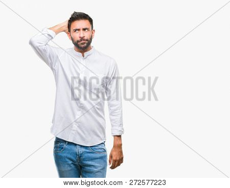Adult hispanic man over isolated background confuse and wonder about question. Uncertain with doubt, thinking with hand on head. Pensive concept.