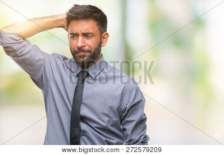 Adult hispanic business man over isolated background confuse and wonder about question. Uncertain with doubt, thinking with hand on head. Pensive concept.